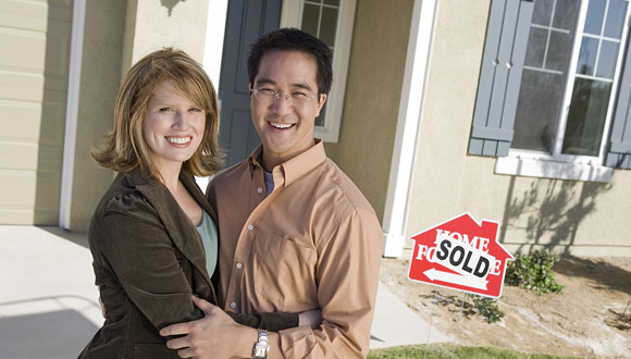 A happy couple who just became new home owners after a great home inspection.
